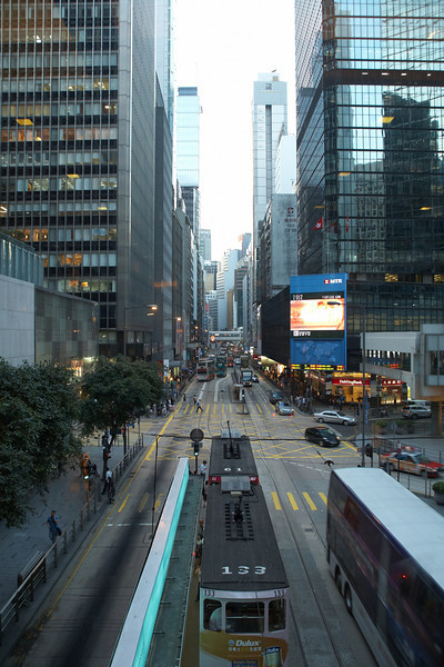 The view of the urban canyon from the open deck of the bus.