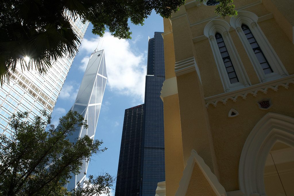 Saint John's Cathedral and its much taller neighbors including the Bank of China (second from the left).