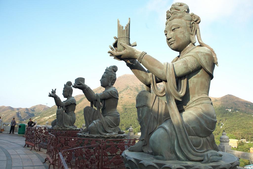 The other three of the six devas kneeling below Buddha.