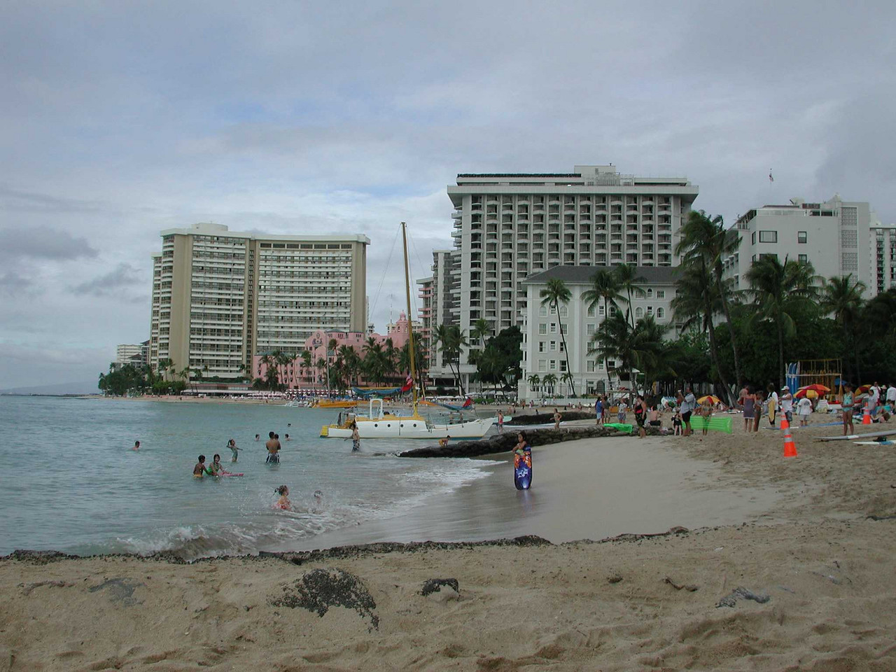 The three buildings in the background (white, pink, then sand) were hotels, and the beaches there were wall to wall with tourists.