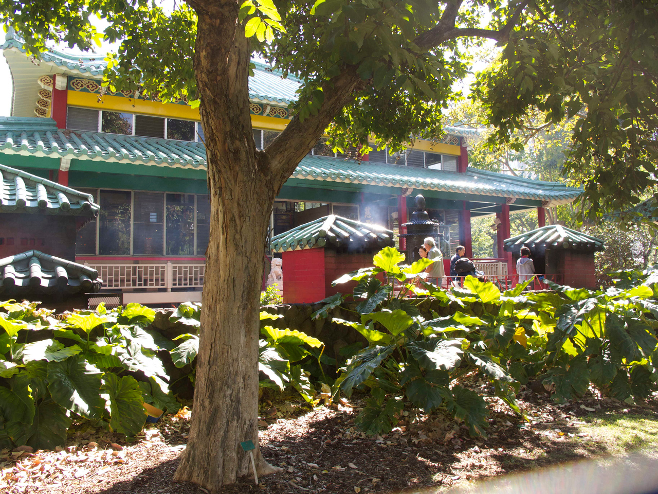Kuan Yin Temple and the smoke from incense wafting on the gentle breeze.