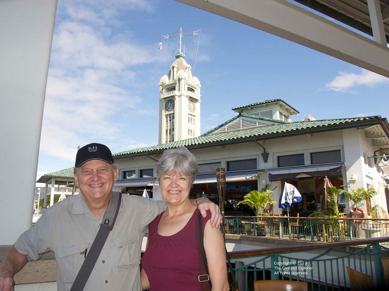 Phil & Louise in a dining area, with the Aloha Tower in the background.