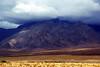 The vast alluvials and shrouded mountains of Nevadan desert.