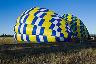 Hot air balloons are being prepared to fly above Sacramento Valley.