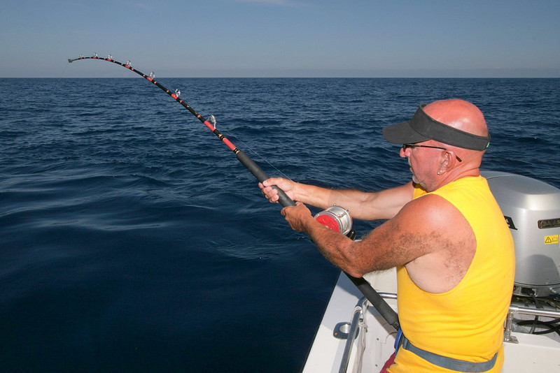 Because the Sea of Cortez is a relativity protected body of water, the seas are often very calm. Here is Fred Edwards working his Tuna to the boat.
