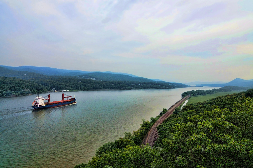 A barge travels northward on the Hudson River near Garrison, New York.