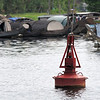 Buoy with floating boat village in the background...it sounded like the Government would like to move most of these people onto land, but easier said than done when families have been living on the river for many generations...