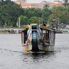 These are the Dragon boats that lead most of the tours up and down the Perfume...