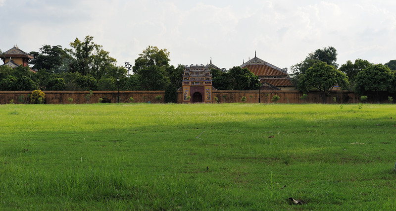 The inside was a series of royal palaces, some separated by huge fields such as this one.  That gate ahead is not an exit, but merely another entrance to the series of buildings that lie beyond...