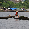 Speaking of work that keeps you in shape, these women haul seaweed out of the river and take it on land to dry...