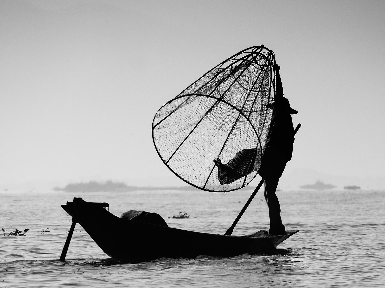 Fisherman and net Inle Lake Myanmar
