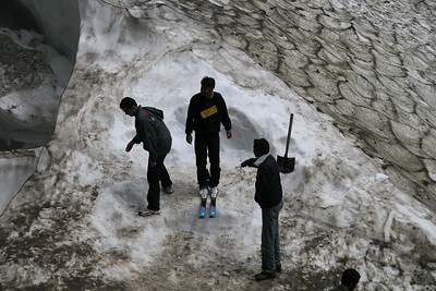 This was an amusement attraction on the pass just north of Manali India, where Indians go to see snow for the first time. In this case, they can pay a few rupees to see what it's like to stand on snow AND stand on skis.  Not actually ski anything mind you, just stand on the skis stuck in the glacier.