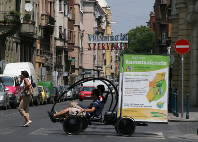 A new twist on taking your advertising to the people - pedal powered. This is actually 2 separate bikers pretty closely lined up.  Buddapest, Hungary