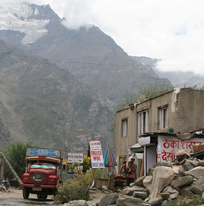 """A little hard to see, but here, up in the Himalaya, in the land of very small towns, we come across a sign for """"English Wine & Beer Shop"""".  really."""