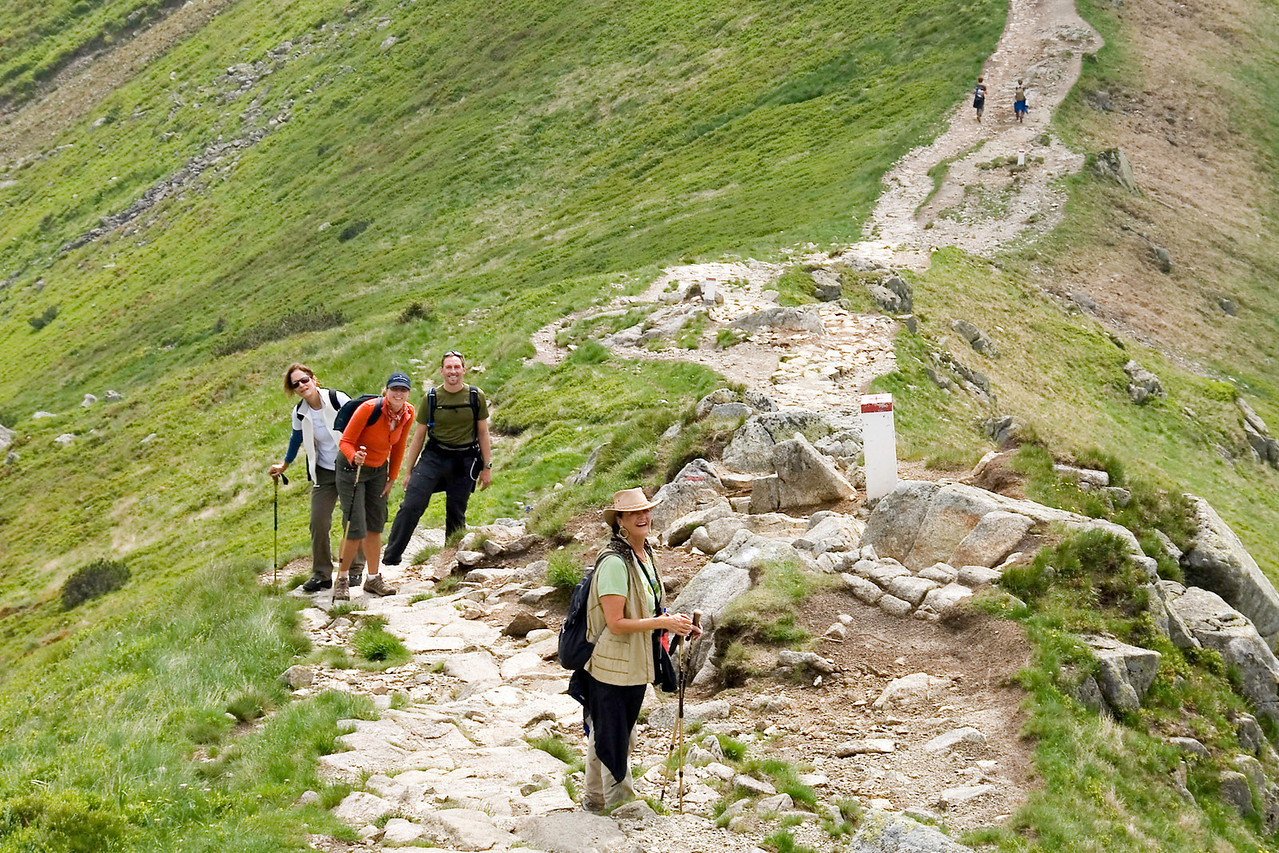 Glory of the High Tatras: The hike begins with an ascent up a rocky incline before reaching the crest that rewards you with breathtaking views of the Zakopane valley.