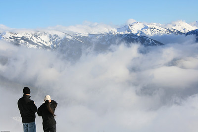 A couple looking at the Olympic mountains