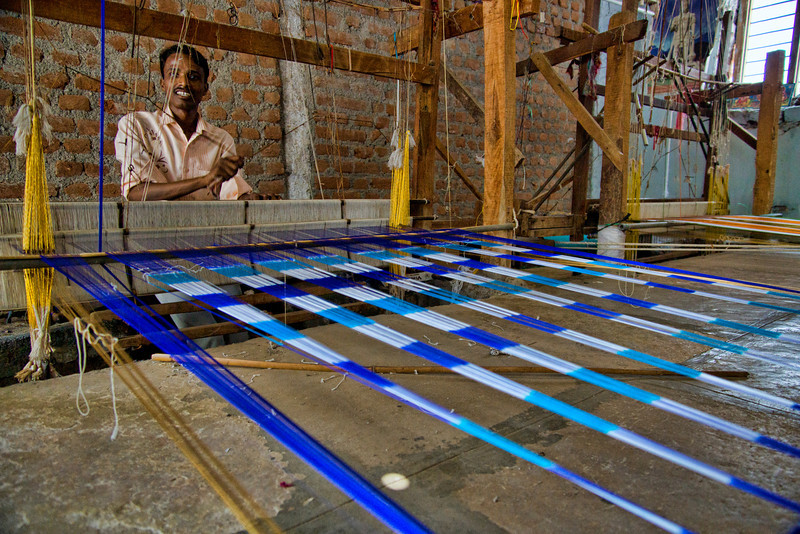 Handloom weaver at work.