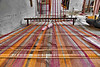 The threads leading into the handloom