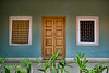 All the doors were adorned on either side with colorful fabric patterns, in VinobaBhave Co-operative Society
