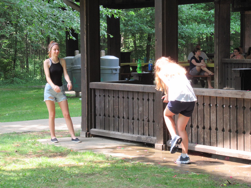 Samantha getting Lauren with the water balloon.
