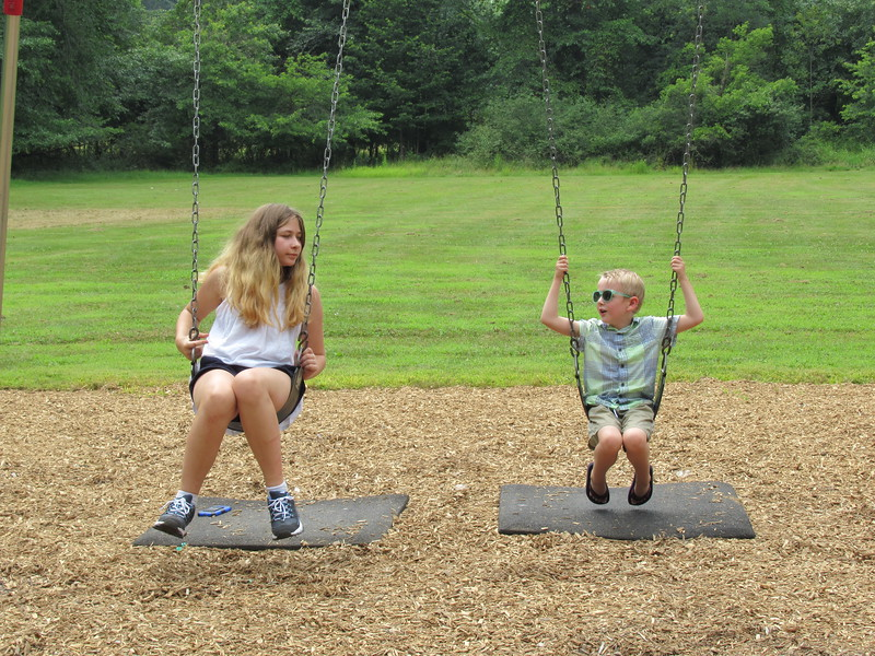Lauren and Ethan on the swings.