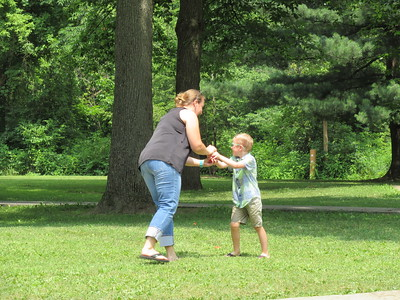Sarah and Ethan with water balloons.