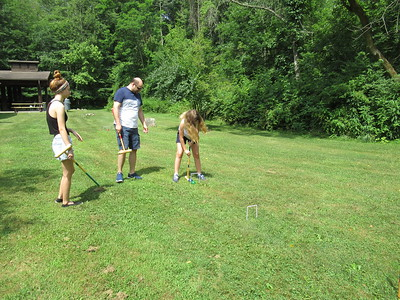 Dave, Samantha and Lauren playing Croquet.