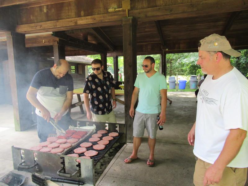 Jake, Dan and Doug giving Dave tips on grilling.