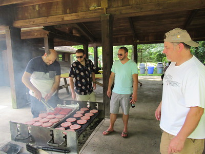 Jake, Dan and Doug giving Dave tips on grilling.