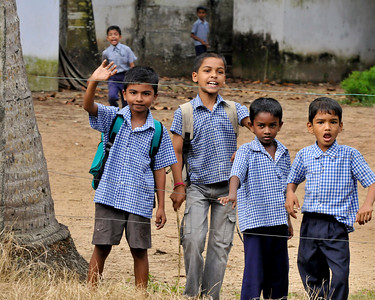 School children in a school along a canal in Kerala