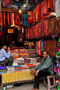 Selling shawls and saris.