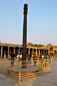 This iron pillar -- which is 7.3 meters tall -- dates from the period 375-414 or even as early as 912 BCE. The intriguing aspect of the pillar is that it has not rusted in about 2000 years. It is known to be 98% iron, 0.25% P, 0.15% C, with much smaller amounts of S, Si, N, Mn, Cu, and Ni. It is apparently the high phosphorus content that has kept the pillar from rusting.  See http://en.wikipedia.org/wiki/Iron_pillar_of_Delhi. Also see refs. therein.
