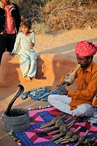 A gypsy snake charmer.