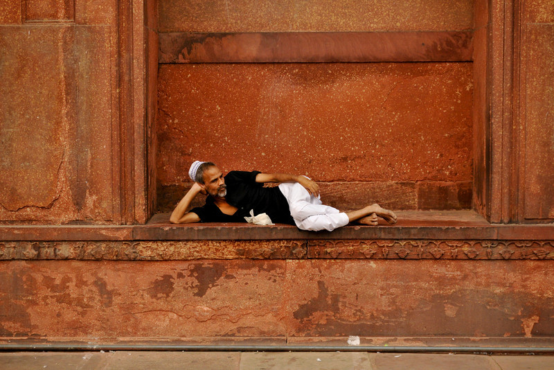 Man relaxing in the Jama Masjid, the largest mosque in India.