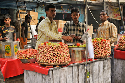 Vegetable sellers. Chandni Chowk, Delhi. Note the small string with green chili peppers and lemon near the bottom. A good luck symbol.
