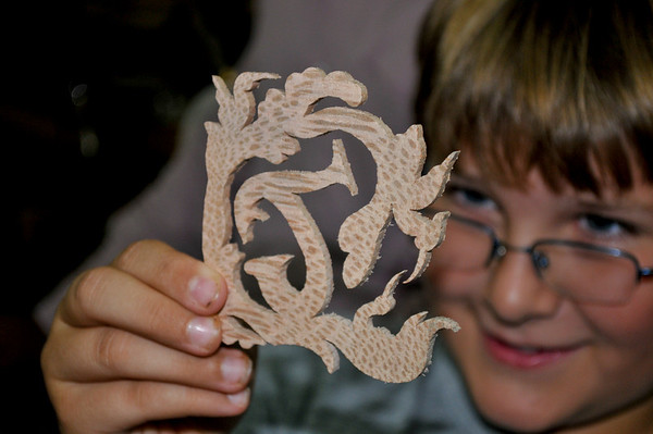 A wood carver made a letter for this young man.