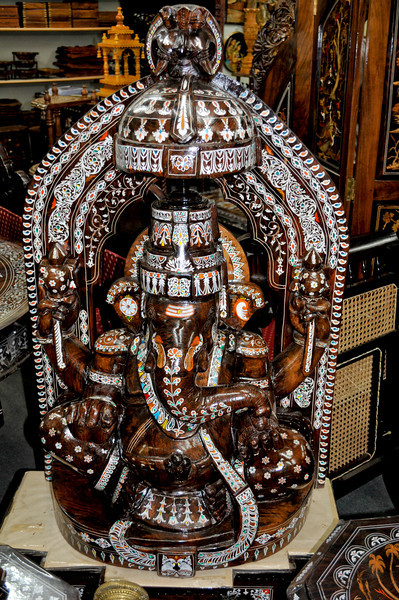 A carved figure of the god Ganesha with intricate inlay. (A ganother ganesha!)