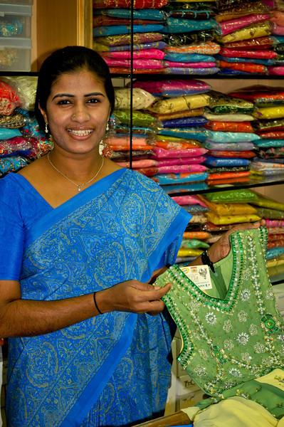 A clerk in a sari shop.