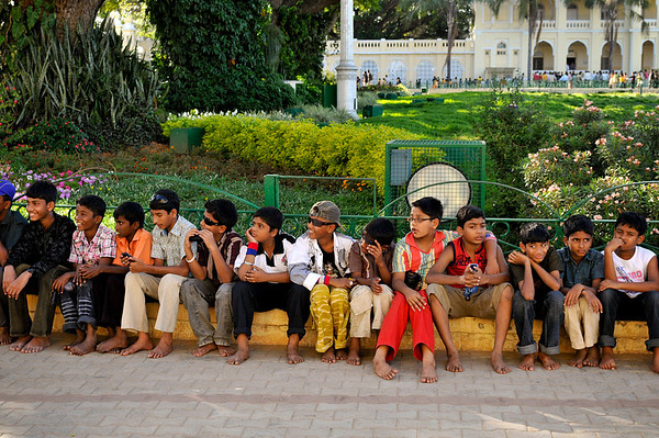 Children waiting to visit the Palace. Notice none have shoes or sandals. One must enter palaces and temples barefoot or with slippers.