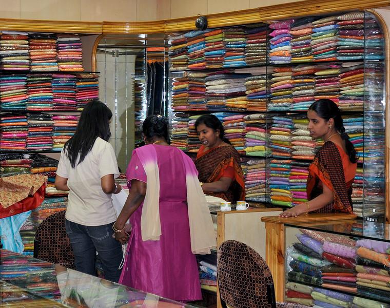 Ladies shopping for saris.