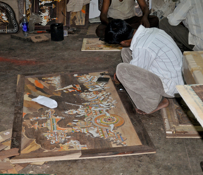 These are workers making very intricate wood inlays.