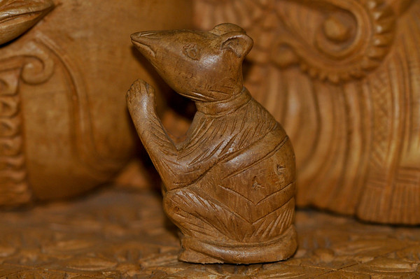 Ganesha figures always have a mouse at his feet. All Hindu gods must have a way to move about and ganesha uses a mouse.