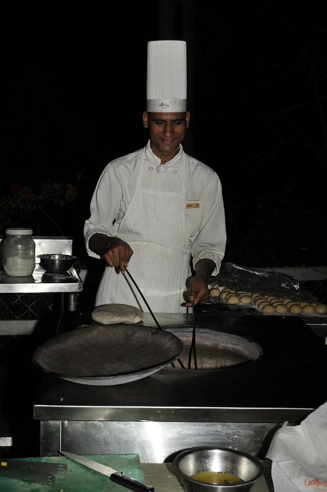 The chef makes naan, delicious bread.