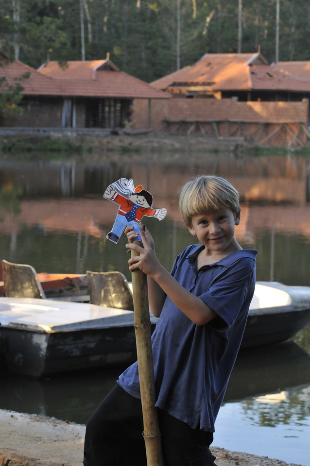 Andy has Flat Stanley at the lake at the Resort.