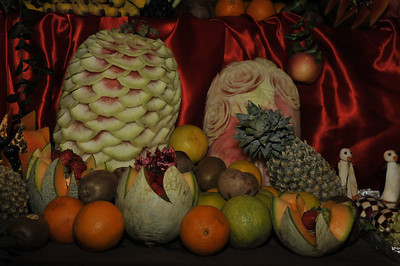 Fruit carving at an evening dinner.