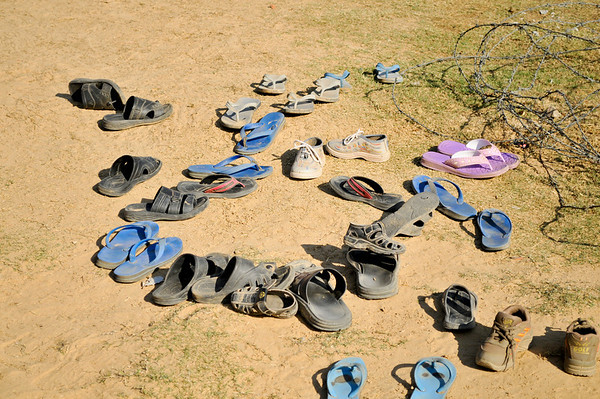 Children always leave their shoes outside.