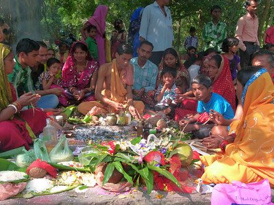 There is an annual Hindu religious pilgrimage to the holy city of Puri.  Many people gather at a place outside Puri where family ceremonies are performed by holy men.  One family at a time goes through the cermony at one of the eight or ten designated spots equipped with a cement pit for a fire where ceremonial offerings of several types are placed in the fire.
