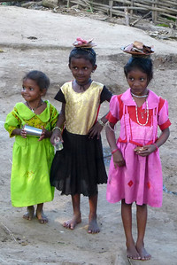 In one tribal village these young girls were developing the skills for being able to carry items on their heads.