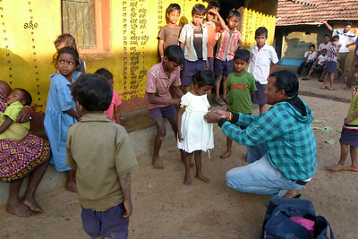 And here in a village our local village guide helps to get the right sized clothing to the right child.  There were many happy faces and smiles for the great variety of items that was given out.
