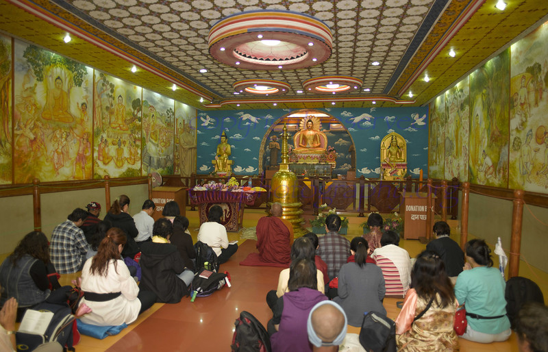 """Worship in the  Sri Lankan Temple, just ouside the Maha Bodhi Temple.<br /> <br /> Click on """"original size"""", then scan the image of Buddha for details."""